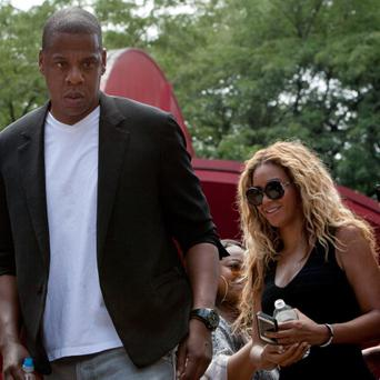 Singer Beyonce and her husband, rapper Jay Z, depart from a rally for Trayvon Martin in New York