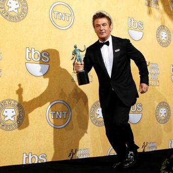 Actor Alec Baldwin with his award for outstanding performance by a male actor in a comedy series for
