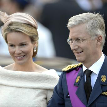 Belgium's Prince Philippe, right, and his wife Princess Mathilde smile as they leave a church service at the St. Gudule cathedral in Brussels
