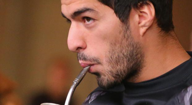 Luis Suarez walks to the team bus to attend training in Melbourne