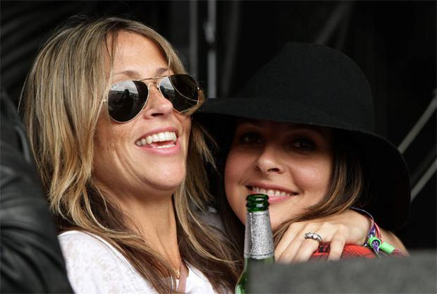 Nicole Appleton (left) watching her husband Liam Gallagher and his band Beady Eye performing at Glastonburyin July 2013