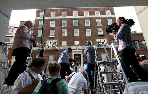 Photographers gather in front of the Lindo Wing of St Mary's Hospital, where Britain's Catherine, Duchess of Cambridge arrived to give birth