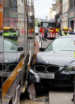 The damaged BMW car and Luas which collided at the Junction of Capel Street and Abbey Street