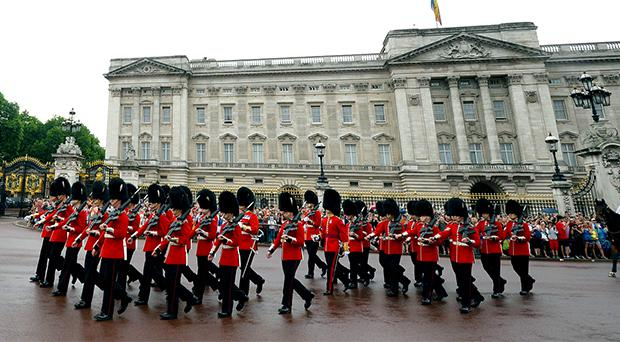 Guardsmen perform the Changing the Guard ceremony in front of Buckingham Palace