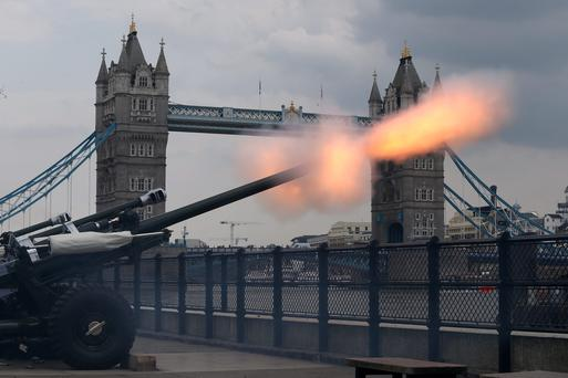 LONDON, ENGLAND - JULY 23: The Honourable Artillery Company fire a 62 round Royal Gun Salute outside the Tower of London to celebrate the birth of the royal baby on July 23, 2013 in London, England. The Duchess of Cambridge yesterday gave birth to a boy at 16.24 BST and weighing 81b 6oz, with Prince William at her side. The baby, as yet unnamed, is third in line to the throne and becomes the Prince of Cambridge (Photo by Jordan Mansfield/Getty Images)