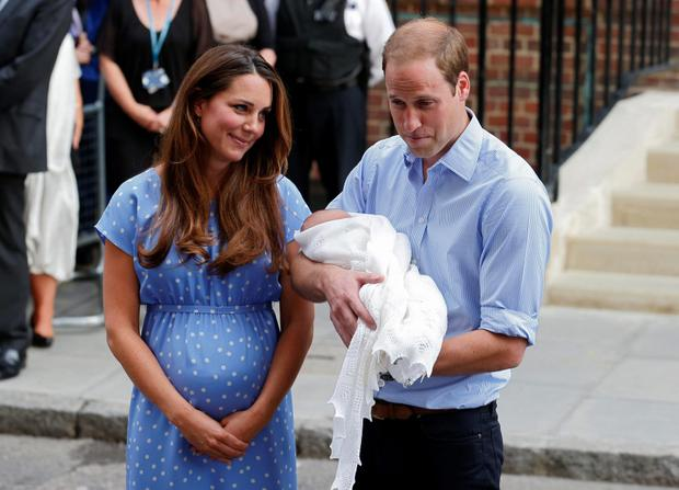 Britain's Prince William and his wife Catherine, Duchess of Cambridge appear with their baby son, outside the Lindo Wing of St Mary's Hospital, in central London July 23, 2013