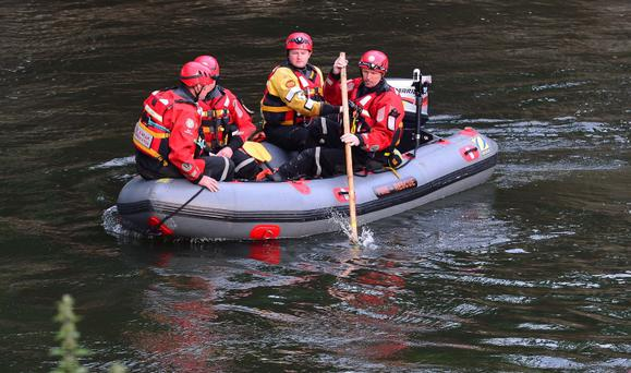 Emergency service personnel search for two girls who vanished after getting into difficulty while playing in the River Wear at Fatfield, Washington, Tyne and Wear