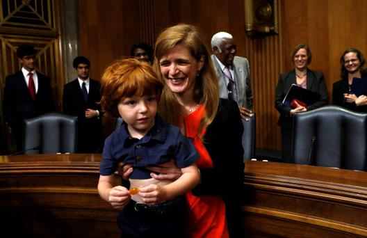 Samantha Power holds up her son Declan after he sat through her Senate Foreign Relations Committee confirmation hearing on her nomination to succeed Susan Rice as U.S. ambassador to the United Nations on Capitol Hill
