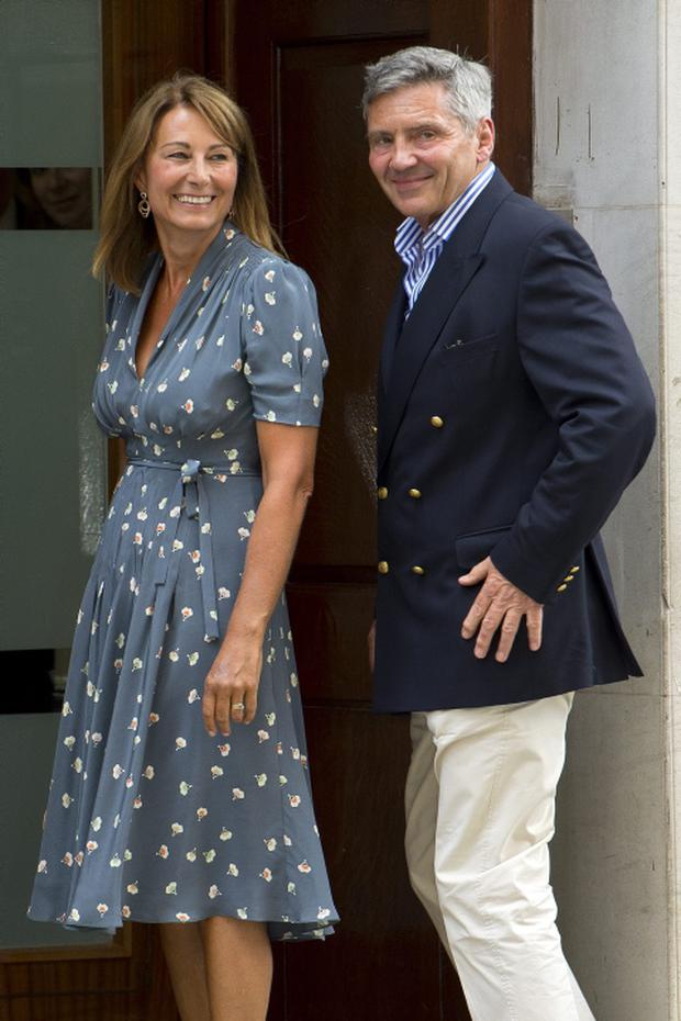 Carole Middleton steps out in Orla Kiely as she arrives at The Lindo Wing after visiting her daughter Kate.