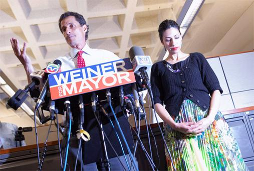 candidate Anthony Weiner and his wife Huma Abedin attend a news conference in New York