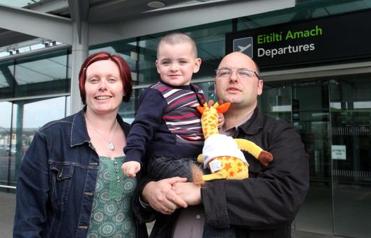 Mary, Liam and Tony Heffernan in 2011, before he underwent surgery in the US for his condition