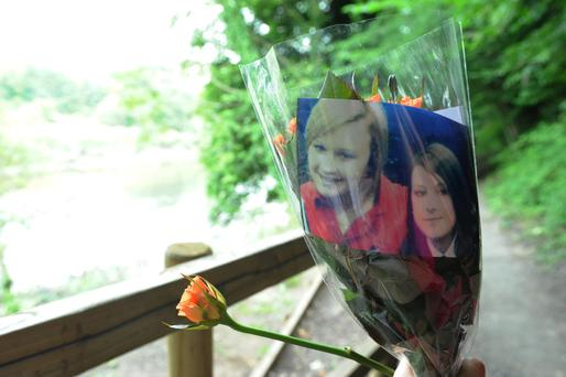 Tributes left by the river where Tonibeth Purvis, 15, from Barmston, Washington, Tyne and Wear, and Chloe Fowler, 14, from Shiney Row, near Sunderland, died after getting into trouble.