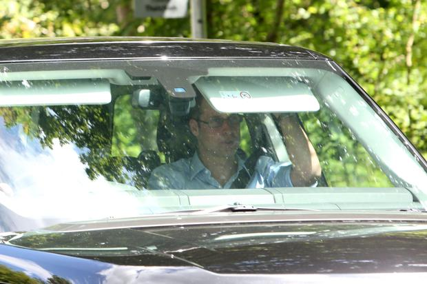 The Duke of Cambridge arrives in Bucklebury, Berkshire, in a car carrying the Duchess of Cambridge and their newborn son.