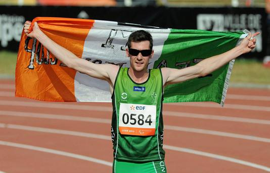 Michael McKillop, from Newtownabbey, Co. Antrim, celebrates after winning the Mens 1500 T38 final, in a championship record time of 4:10.17.