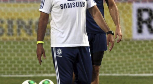 Chelsea's manager Jose Mourinho, front, and player Frank Lampard attend a training session at Rajamangala national stadium in Bangkok, Thailand