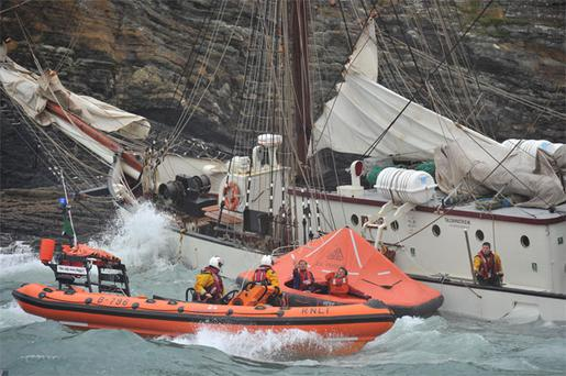 Thirty sailors – including eight teenage Irish trainees – cheated death as they were dramatically rescued from the 42-metre Tall Ship 'Astrid' just minutes before it was smashed to pieces on rocks off the Co Cork coast