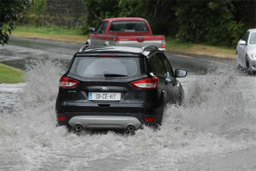 A motorist battles the elements in Crusheen, Co Clare