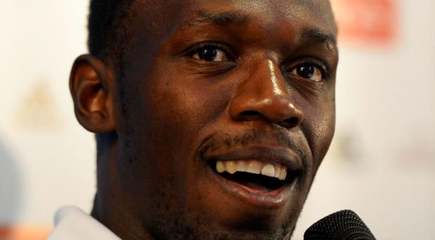 Jamaica's sprinter Usain Bolt speaks to journalists during a news conference one day before a Diamond League athletics meet in London July 25, 2013