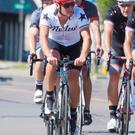 Lance Armstrong (2nd L) prepares to take part in The Des Moines Register's Annual Great Bicycle Ride Across Iowa
