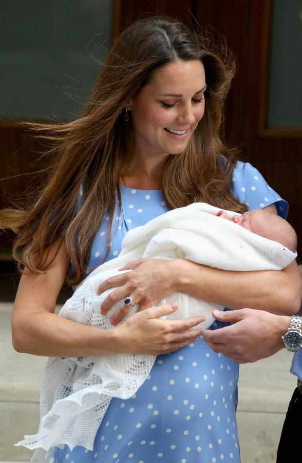 Duchess of Cambridge introducing Prince George to the world