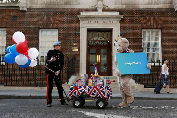 A lookalike of Britain's Prince Harry takes part in a publicity stunt in front of the door to the Lindo Wing of St Mary's Hospital.