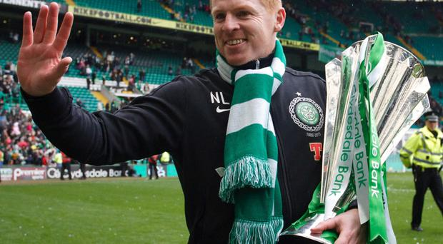 Celtic manager Neil Lennon with the SPL trophy in May