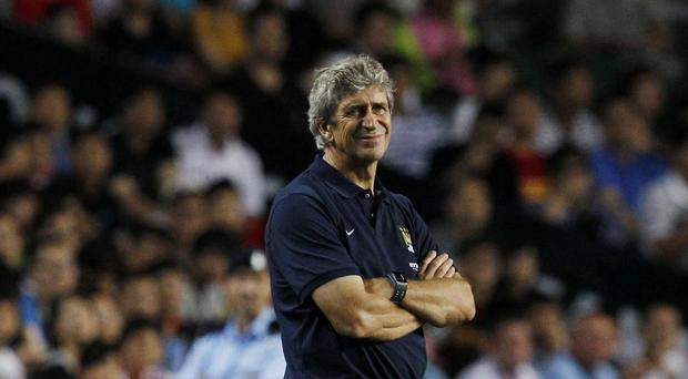 Manchester City's manager Manuel Pellegrini watches their match against South China FC at the Barclays Asia Trophy in Hong Kong this week
