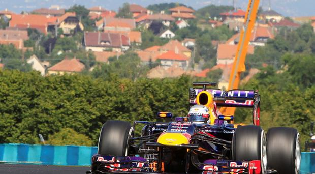 Red Bull Formula One driver Sebastian Vettel of Germany drives during the first practice session of the Hungarian F1 Grand Prix at the Hungaroring circuit in Mogyorod, near Budapest
