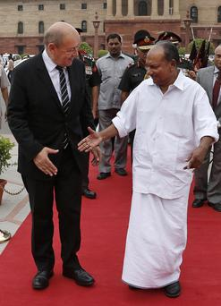 French Defense Minister Jean-Yves Le Drian, left, is received by his Indian counterpart A.K Antony in New Delhi, India, Friday, July 26, 2013.