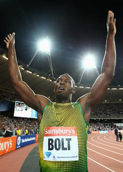 Usain Bolt of Jamaica celebrates after crossing the line first in the Men's 100m A race on day one during the Sainsbury's Anniversary Games