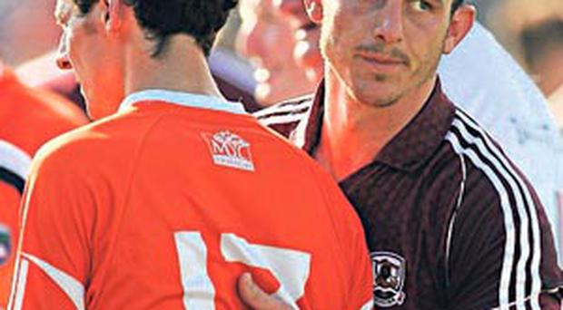 Galway's Sean Armstrong commiserates with Armagh's Jamie Clarke last week