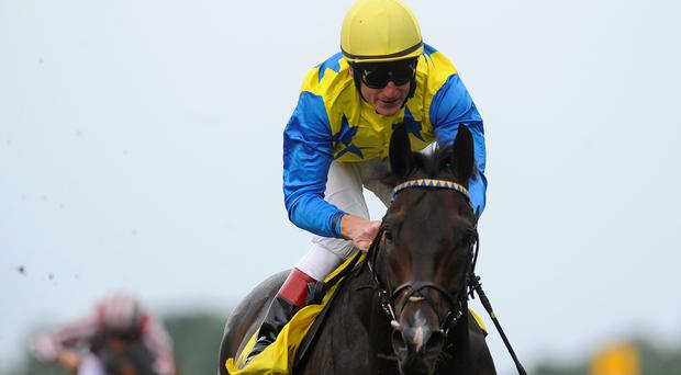 Johnny Murtagh riding Novellist win The King George VI and Queen Elizabeth Stakes at Ascot