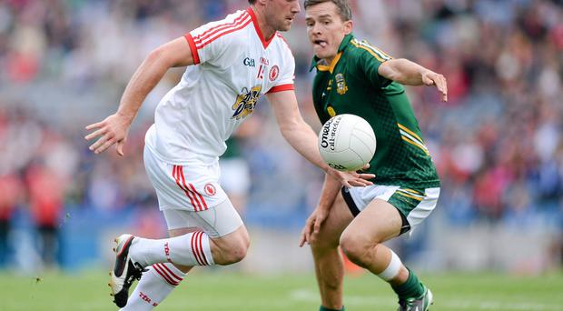 Martin Penrose, Tyrone, in action against Seamus Kenny