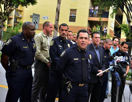 Police hold a news conference outside an apartment building after a shooting incident which began Friday evening left seven people dead in Hialeah, Florida, July 27, 2013. A tenant went on a shooting rampage at a Florida apartment building, killing six people before a SWAT team killed him and rescued two neighbors he was holding hostage on Saturday, police said. The hostages were unharmed, police in the Miami suburb of Hialeah said. REUTERS/Gaston De Cardenas (UNITED STATES - Tags: CRIME LAW)