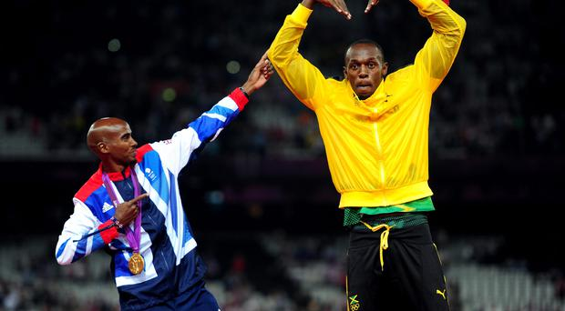 Mo Farah celebrating with Usain Bolt after victory in the Men's 5000m final on day fifteen of the London Olympic Games last year