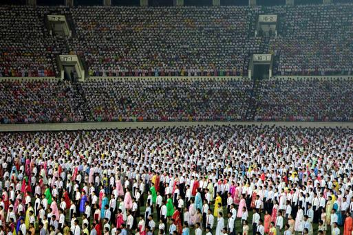 Thousands of North Koreans attend a celebration event to commemorate the 60th anniversary of the signing of a truce in the 1950-1953 Korean War, at Kim Il-sung Stadium in Pyongyang July 28, 2013.