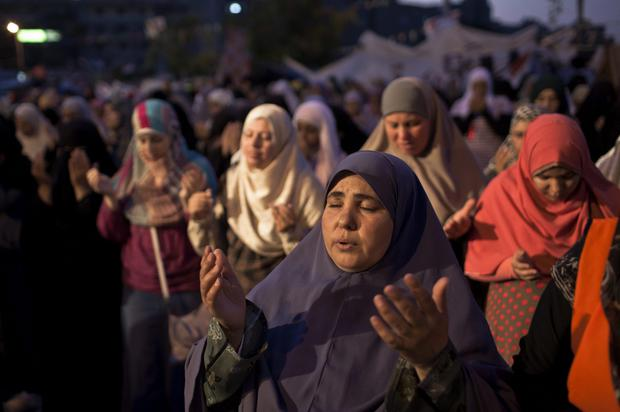 A supporter of deposed Egyptian President Mohammed Morsi prays prior to the 'iftar' fast-breaking meal at a sit-in protest at the Rabaa al Adweya Mosque in the Nasr City district on July 28, 2013 in Cairo, Egypt