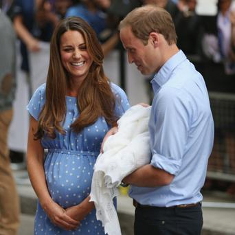 Prince William and Kate leave St Mary's Hospital with their newborn son