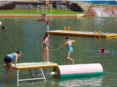 Children play in the Willow Springs Water Park in Little Rock, Arkansas, which has been closed
