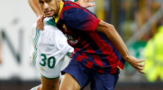 Barcelona's Neymar (R) and Lechia Gdansk's Maciej Kostrzewa fight for the ball during their friendly soccer match in Gdansk July 30, 2013