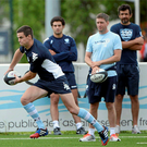 Jonathon Sexton pictured at a training session, watched over by Ronan O'Gara, in France