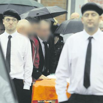 Mourners at the funeral of Larry Keane today