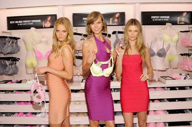 Models Erin Heatherton, Karlie Kloss and Behati Prinsloo attend Victoria's Secret Celebrates Body By Victoria on July 30, 2013 at Victoria's Secret Soho in New York City. (Photo by Jamie McCarthy/Getty Images for Victoria's Secret)