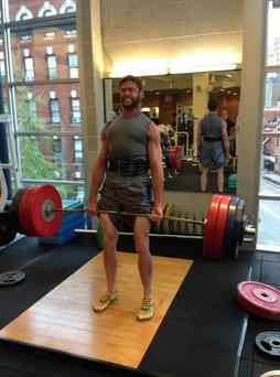 The Wolverine actor shared this photo of himself lifting weights online.