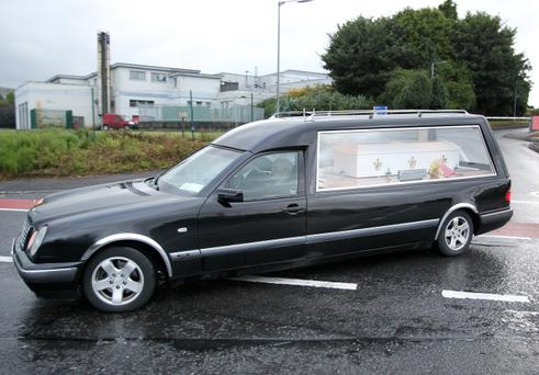 The hearse carring the remains of brothers Eoghan and Ruairi Chada pictured leaving Mayo General Hospital with a Garda Escort in Castlebar last evening. Pic Frank Mc Grath