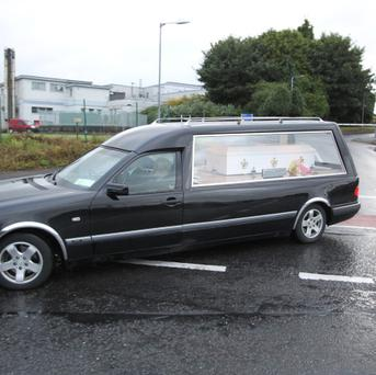 The remains of Eoghan and Ruairi Chada being taken from Mayo General Hospital. Photo : Keith Heneghan / Phocus.