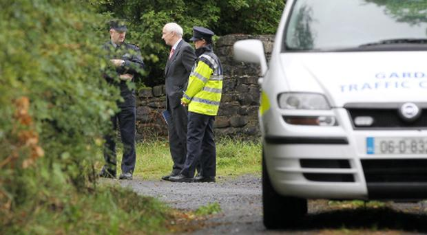 Senior gardai pictured at a small boreen outside Ballintubber in Co Mayo where they believe brothers Eoghan and Ruairi Chada may have died