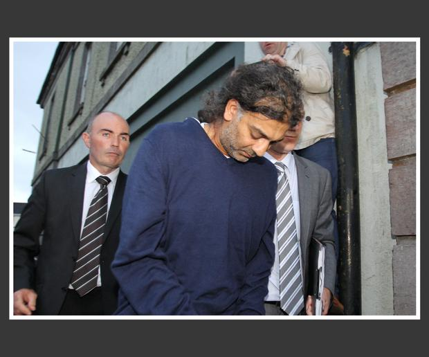 Sanjeev Chada flanked by detectives at an earlier court hearing. Pic Frank Mc Grath