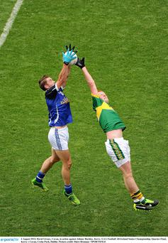 David Givney, Cavan, in action against Johnny Buckley