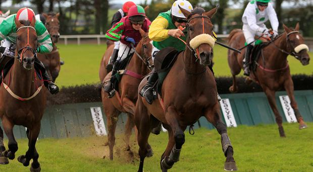 Busted Tycoon under Ruby Walsh (centre) jumps the last to win the Vision Express European Breeders Fund Mares Handicap Hurdle and in doing so wins three times at the festival